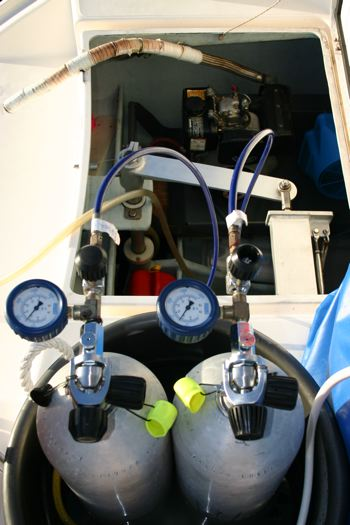 Electric compressor aboard our catamaran