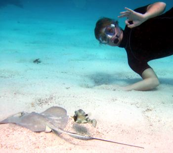 Me enjoying diving with a ray